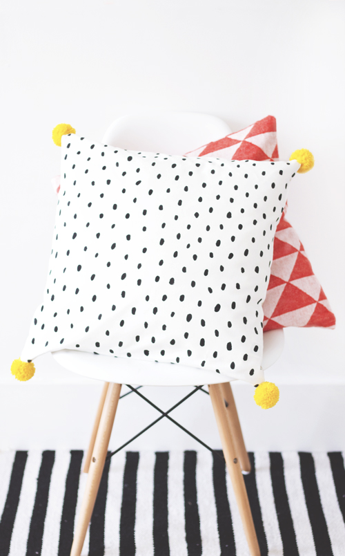 "And  these painted pillows from The Lovely Drawer  are similar, but I love the pom poms and the polka dots. I seem to be drawn to black and white patterns lately...so I'm thinking my ""funky"" pillows for my sofa styling will probably have some kind of black and white theme. :)"