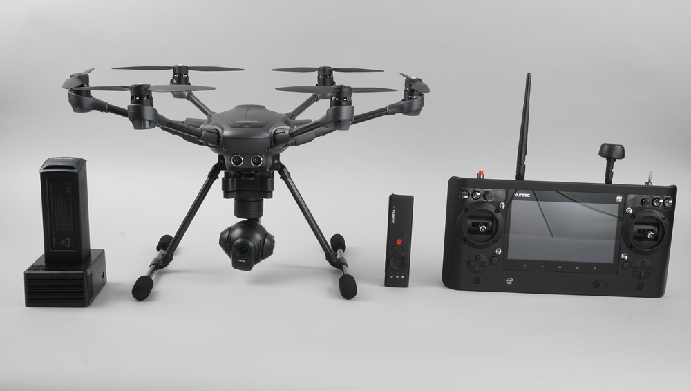 A battery,  Typhoon H, secondary Wizard remote, and built-in touch screen controller.
