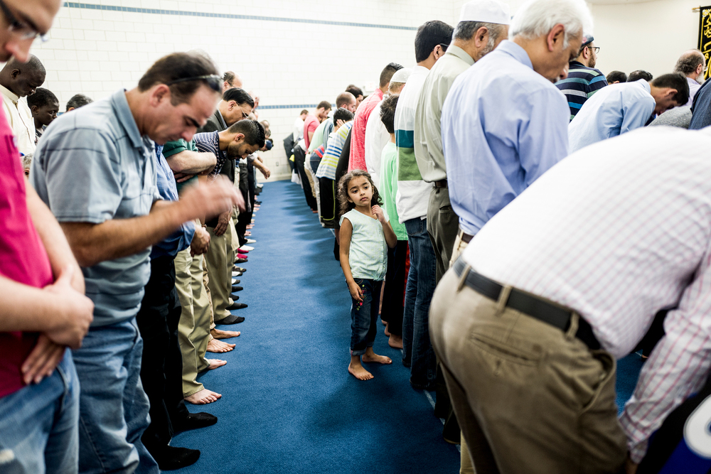 Members of the local Muslim community participate in Friday Prayers at the Unity Center. The center serves as a mosque, school, and meeting space. It is a central hub for the community, where many of the area refugees go to pray.