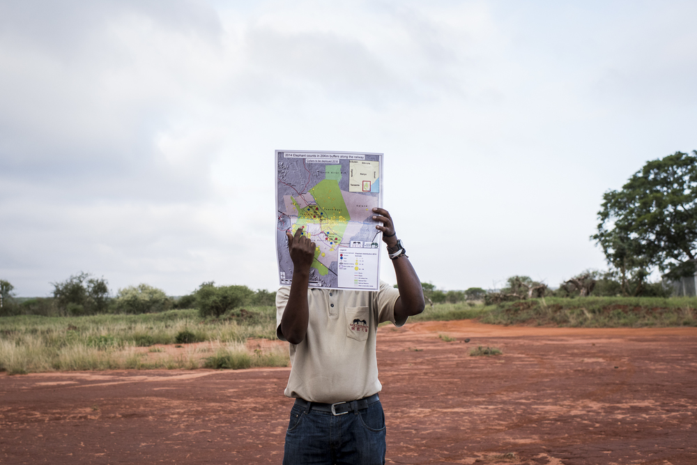 Dr. Ben Okita, Head of Research Operations of Kenya based NGO, Save The Elephants, points out locations where an elephant collaring operation will take place throughout the Tsavo National Parks in Kenya on March 15, 2016.