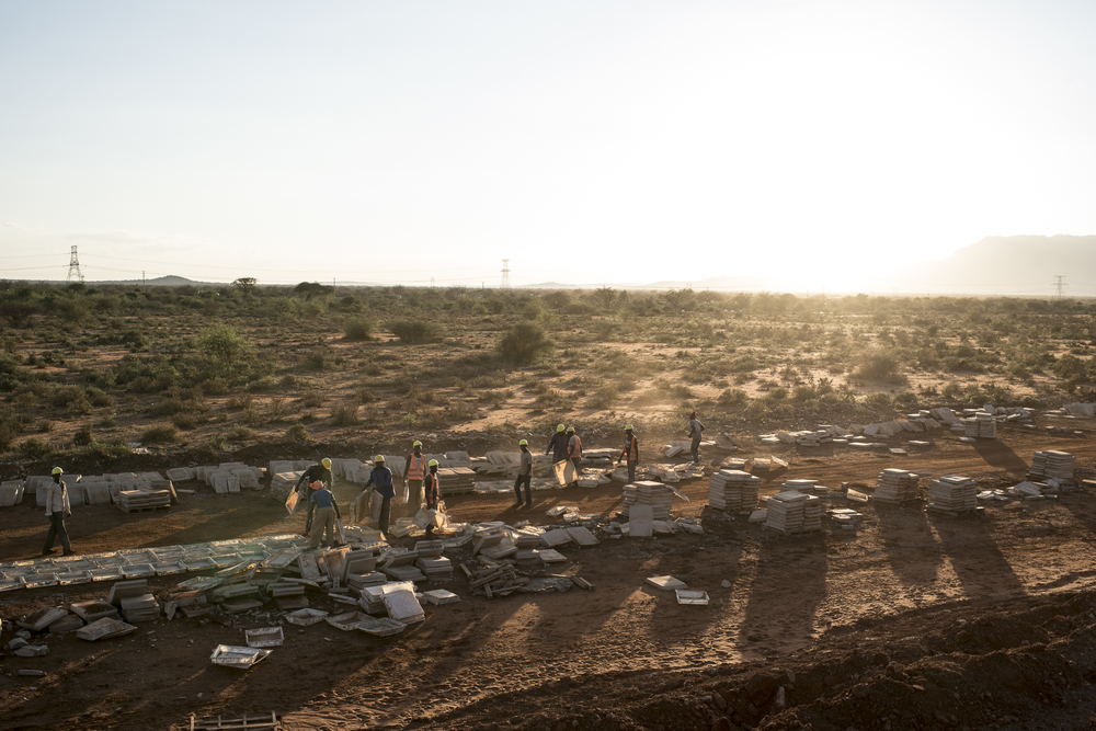 Men work work on a section of the Standard Gauge Railway that runs through the Maungu area of Tsavo East National Park in Kenya on March 15, 2016. Approximately 12,000 elephants live in the Tsavo Conservation area according to a 2012 census.