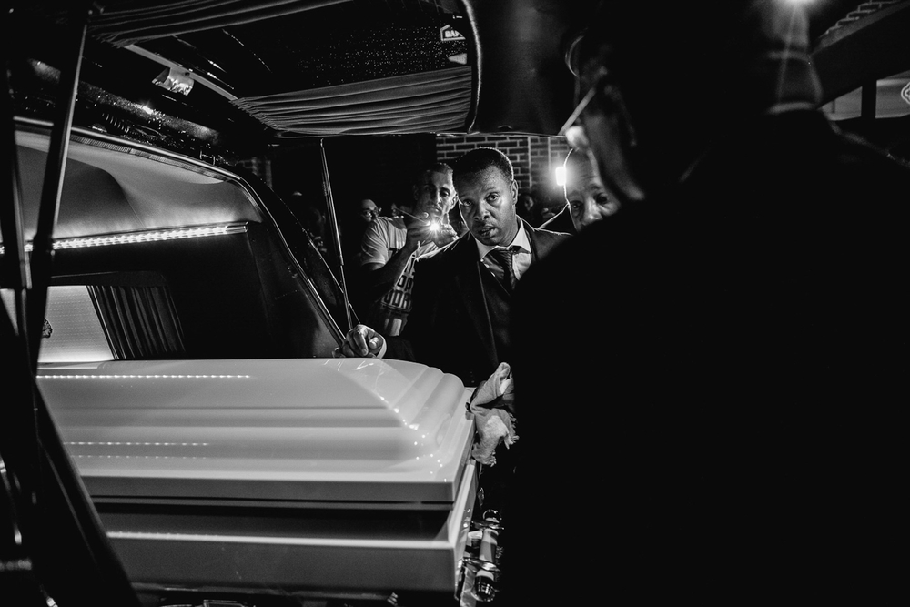 USA. Brooklyn, New York. July 23, 2014 : The casket of Eric Garner is placed into the hearse after his funeral at Bethel Baptist Church in Brooklyn, New York. Garner died after being placed in an illegal chokehold by an New York Police Department officer during a confrontation.