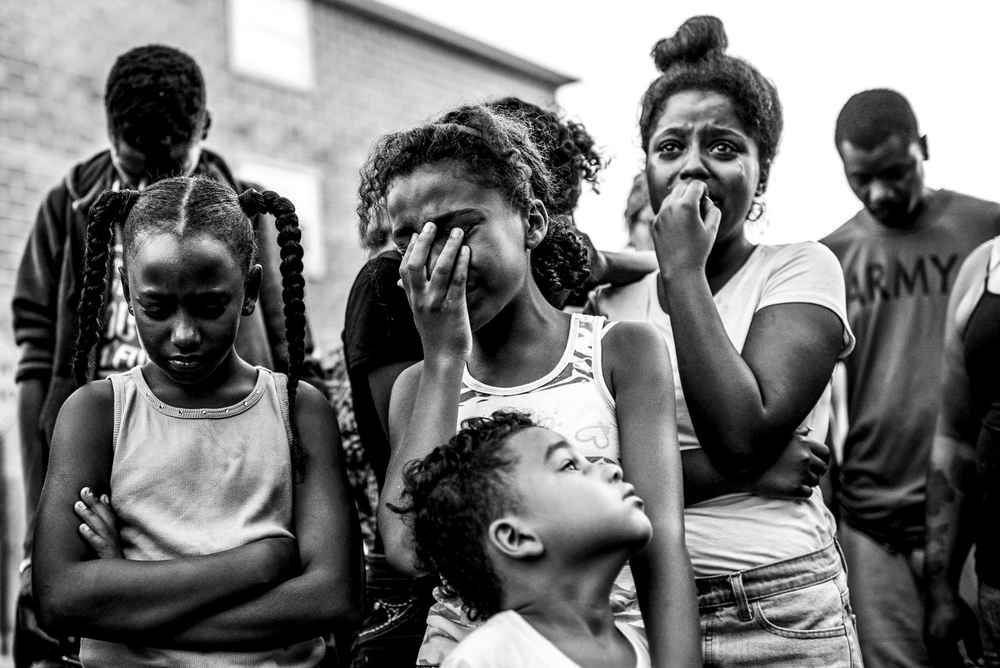 USA. Far Rockaway, New York. September 1, 2015 : A vigil is held for Newshawn Plummer at the spot where he was killed on Beach 26th Street and Seagirt Avenue in Far Rockaway. Plummer, 16, was shot a few blocks away from where his brother was killed 3 years ago.