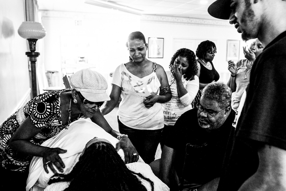 "USA. Mays Landing, New Jersey. June 25, 2012 : The body of Zach ""Zooty Bang"" Taylor is mourned by friends and family members at a funeral home in Mays Landing, New Jersey.  An aspiring rapper, Taylor was 19- years-old when he was shot to death in Atlantic City's Westside, making him the city's ninth victim of homicide in 2012."