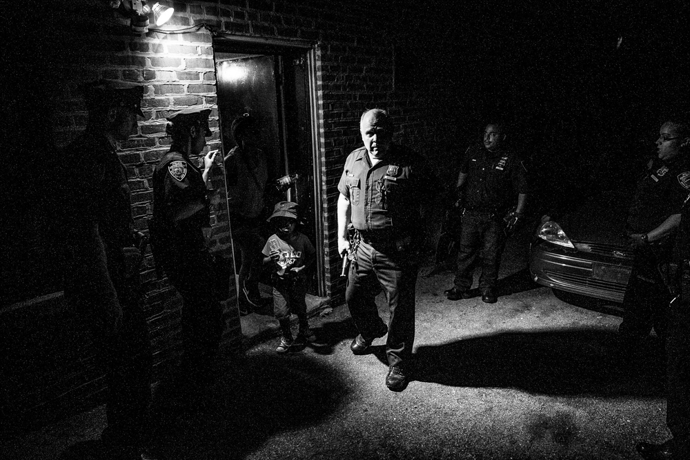 USA. The Bronx, New York. July 23, 2014 : Police from the 47th Precinct in the Bronx at a domestic violence call in a fight between a mother and her daughter.  This particular area in the Bronx saw surge in violence in 2014, including the slaying of a teenager by a nearby playground and an execution style murder where a 25-year-old man was shot three times in the head and once in the back.