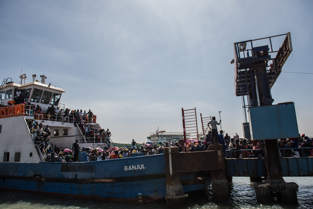 THE GAMBIA. Banjul. January 22, 2017. A ferry carrying people who fled Gambia arrives in Banjul a day after authoritarian ex-president Yahya Jemmeh left the country, on January 22, 2017 in Banjul, The Gambia. Jammeh was defeated by the current president, Adama Barrow, ending his 22 year rule.