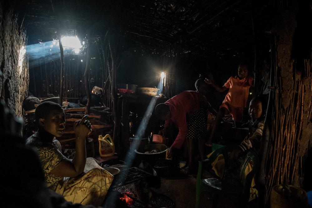 The Saiyanga family has morning tea at their home in the Langata neighborhood of Nairobi, Kenya on November 1, 2016. Masai herders move their cattle from southwestern Kenya to graze in Nairobi when the land is too dry to raise livestock.