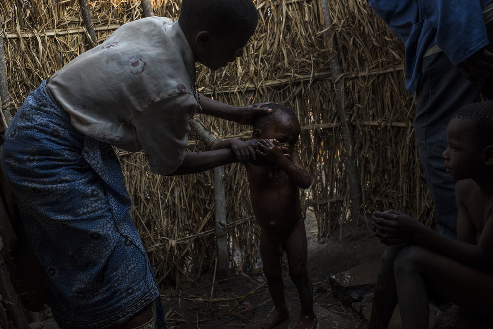 Margaret Majawa washes her son, Akuzike, 2, before church at their family home in the village of Masale, which lies in one of the areas most affected by drought, on September 11, 2016 in Zomba, Malawi. The drought has hurt the Majawa's harvest of maize and sunflowers, and without food aid the family would starve.