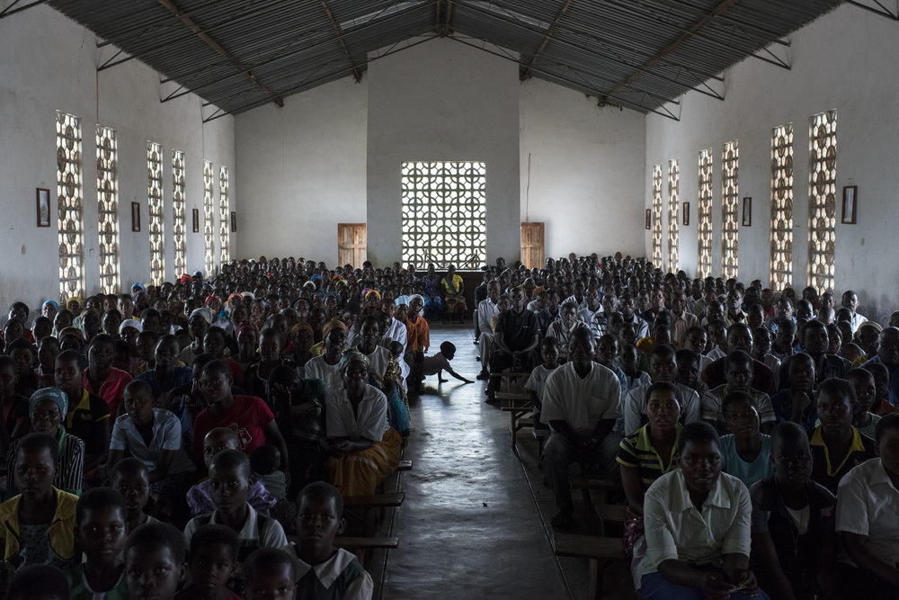 People gather for Sunday service at Mofolo Woyera church in the village of Mulele, which lies in one of the areas most affected by drought, on September 11, 2016 in Zomba, Malawi. The drought has hurt the community's harvest leaving many in need of food aid.