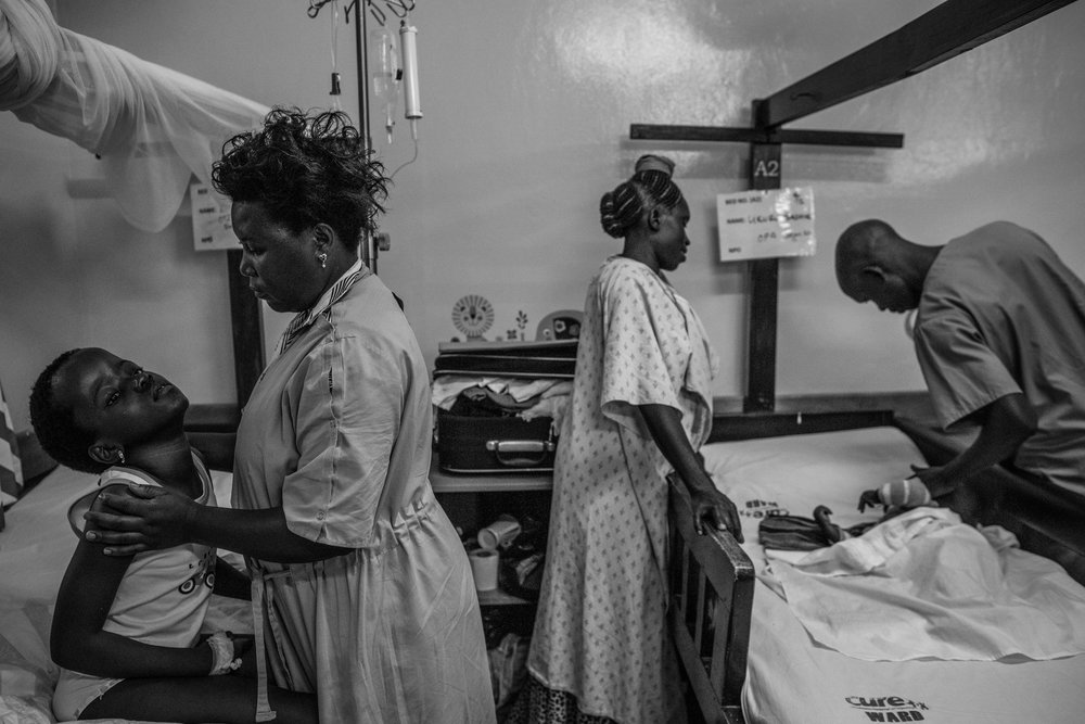 Patients with Hydrocephalus wait for a nurse to make his rounds at Cure Hospital on February 4, 2017 in Mbale, Uganda.