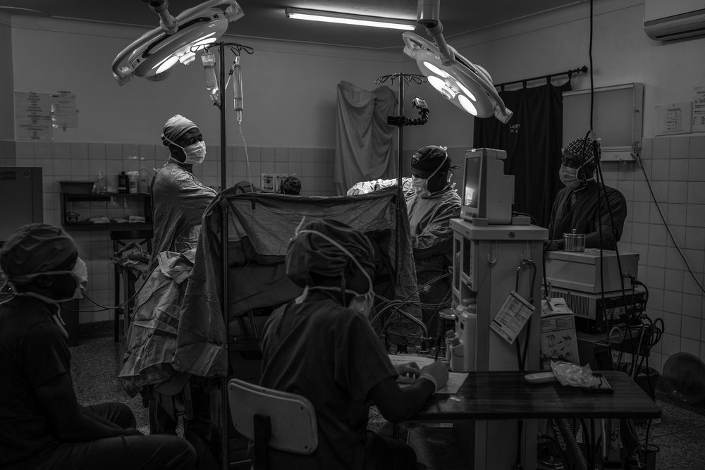 Doctors operate on a patient at Cure Children's Hospital in Mbale, Uganda on February 6, 2017. The hospital has performed more than 10,000 life-saving surgeries on children with hydrocephalus