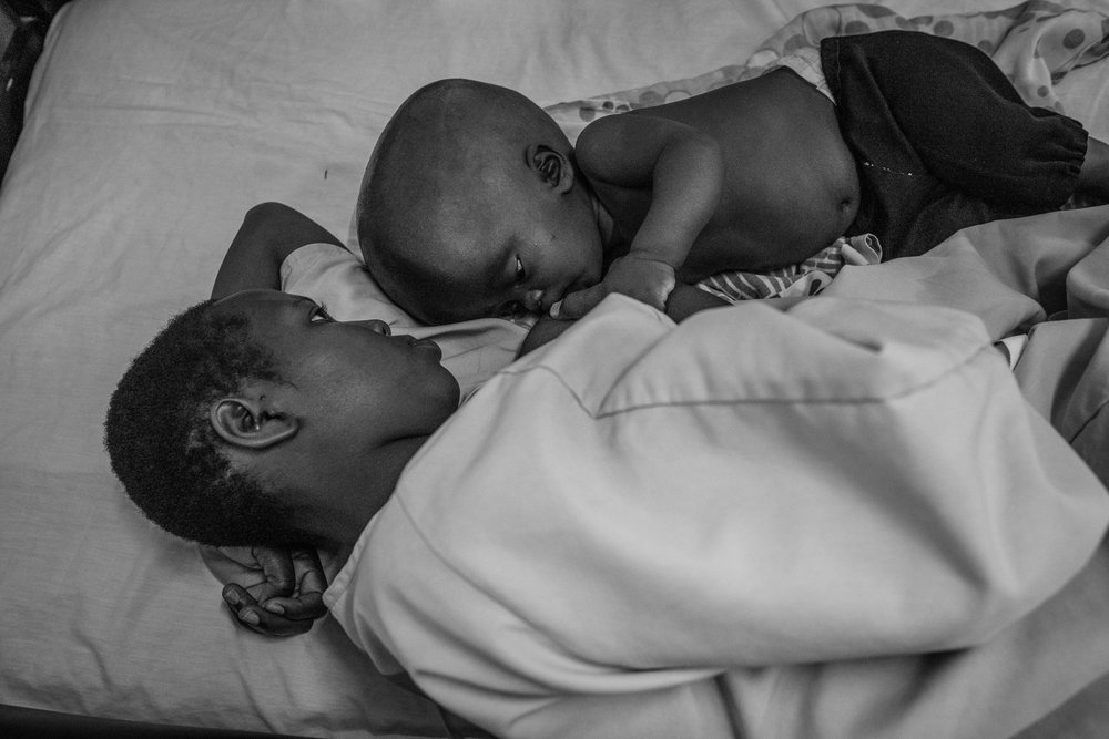A mother breastfeeds her son at Cure Hospital on February 5, 2017 in Mbale, Uganda. There are an estimated 400,000 cases of hydrocephalus in the world every year; more than 300,000 of them are in developing nations, and 90% will be fatal without surgery.
