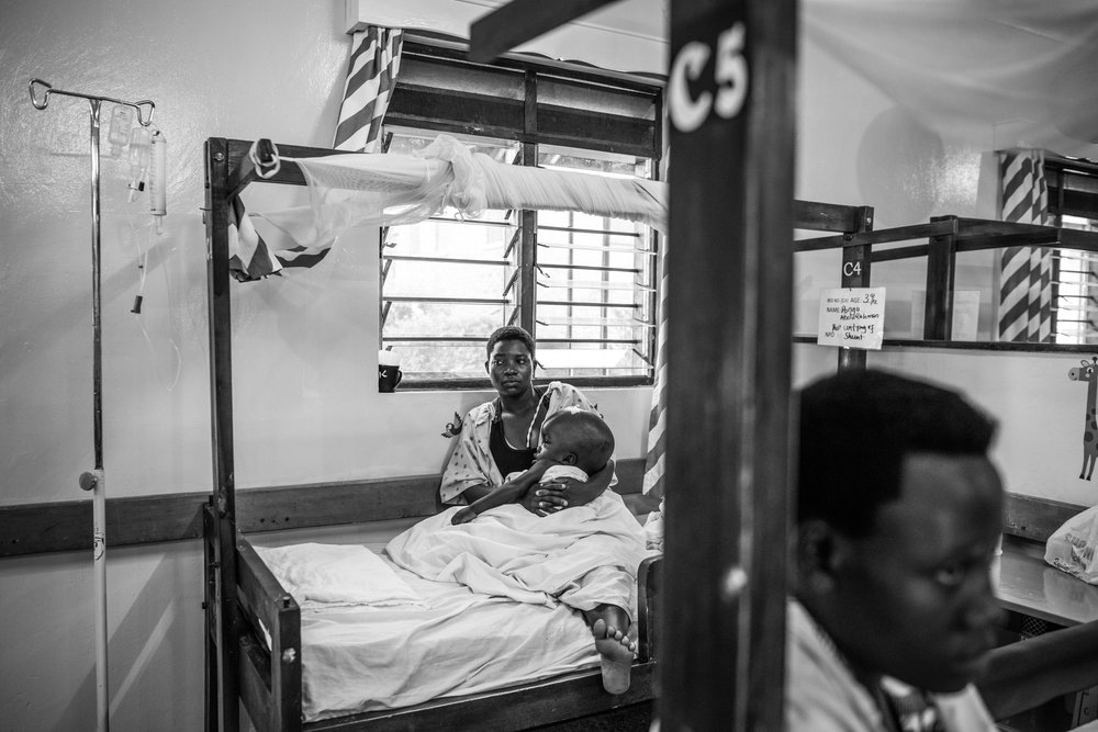 Amina Naikjoba sits with her son Pongo, 3, at Cure Children's Hospital on February 6, 2017 in Mbale, Uganda. Pongo developed an infection associated with the shunt in his head following treatment for Hydrocephalus.