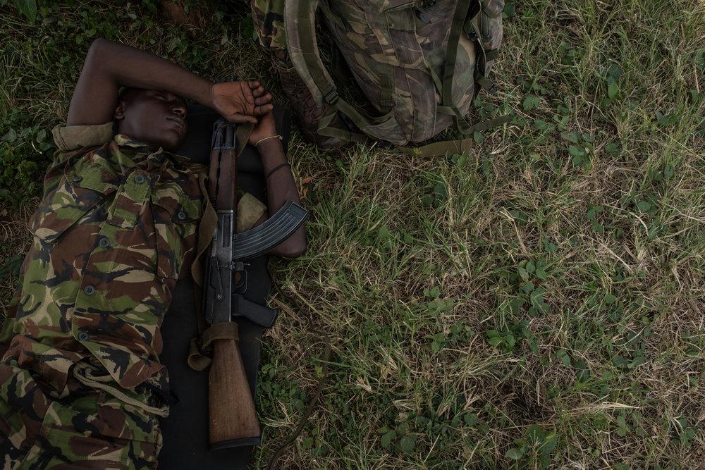 Ranger Amatimi Mbia sleeps during a break at the Bagunda outpost in Garamba National Park on November 28, 2017.