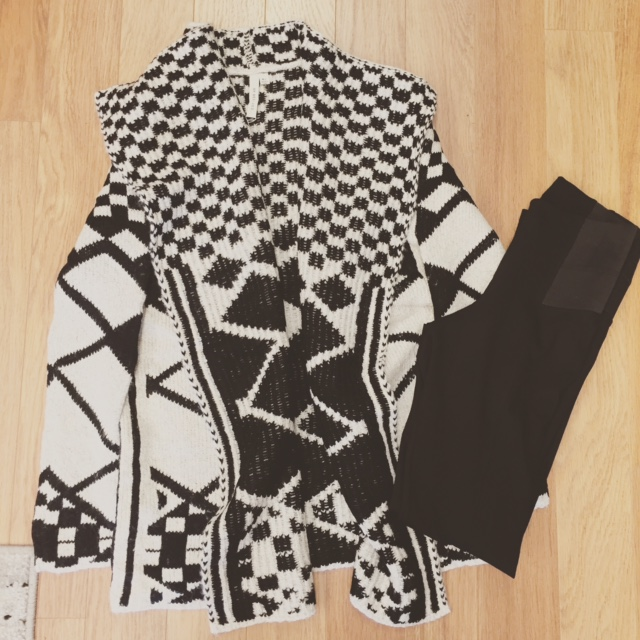 Very comfortable oversized sweater with checker detail. $52. Pictured with black leggings $35