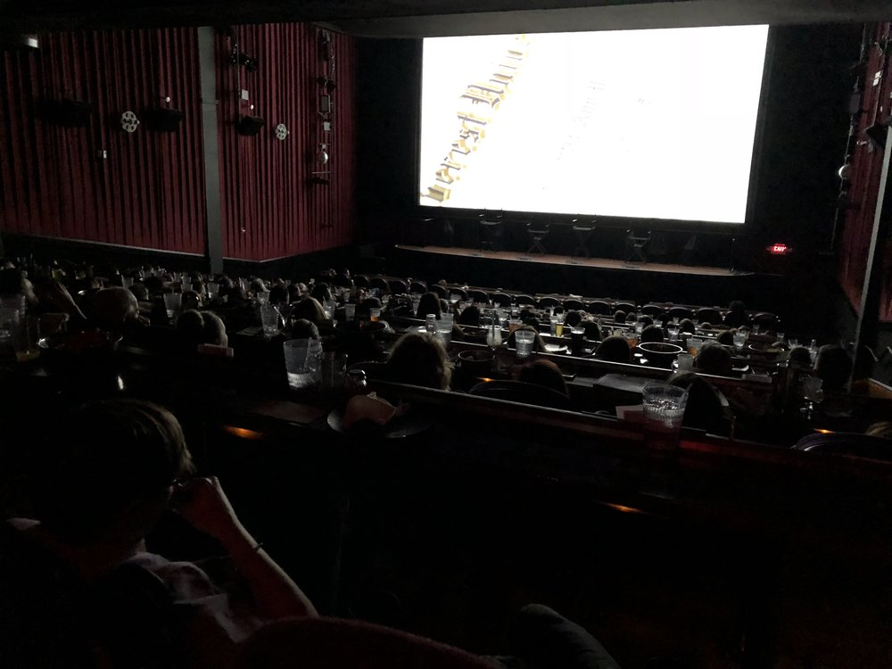 The audience watches the film.