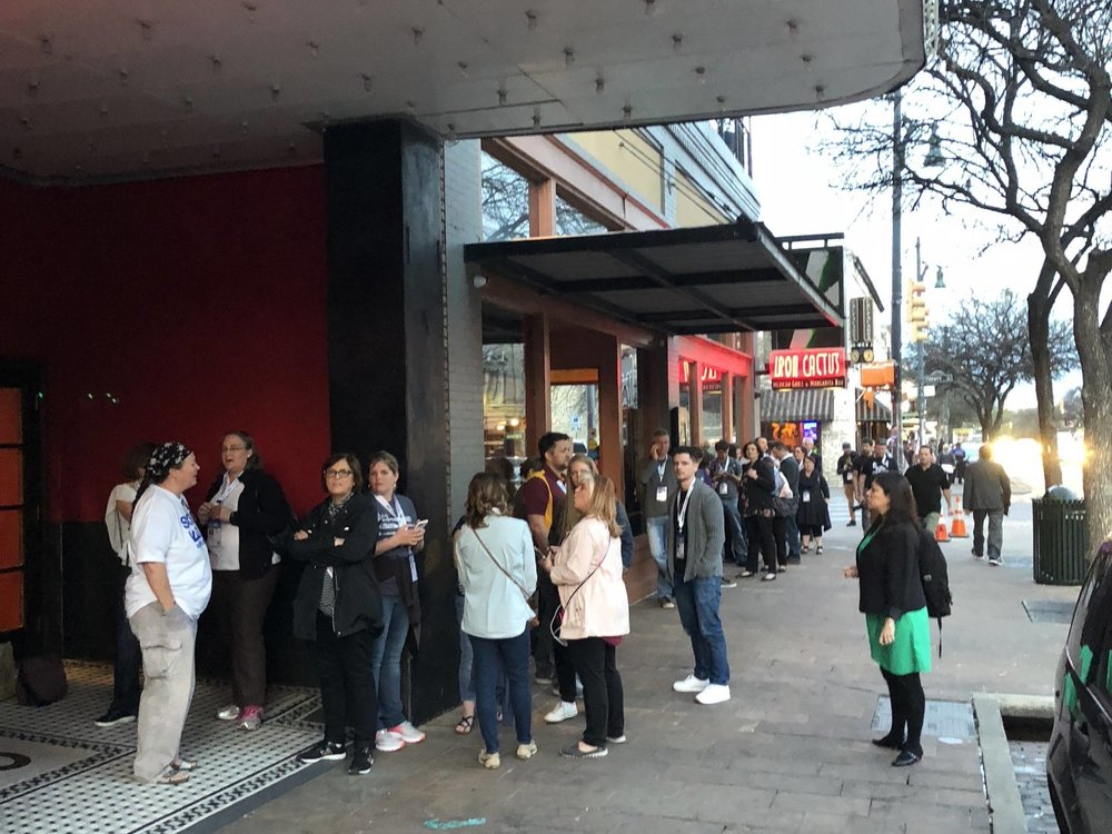 30 minutes before the screening, a line of people forms outside the theater.