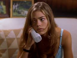 Denise Richards, waiting, hoping for me to answer.