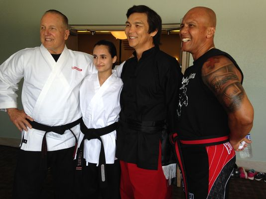 "Grandmaster Jeff W. Smith, left, a young black belt, Don ""The Dragon"" Wilson and Olando Rivera filmed some fighting scenes in late June at the Cocoa Beach Country Club with more than 100 extras from Brevard and across Florida.    (Photo: Jennifer Sangalang, FLORIDA TODAY)"