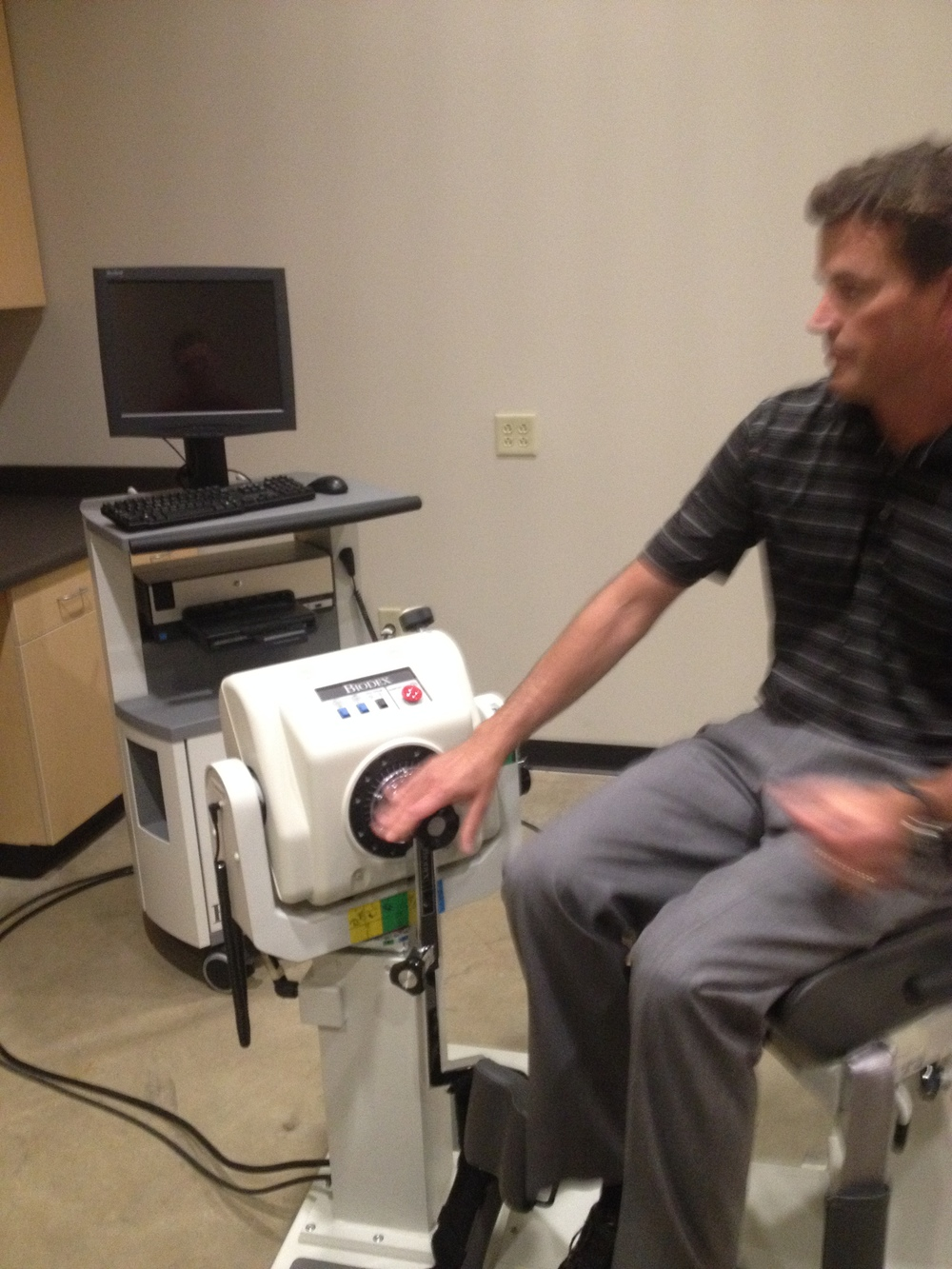 Dr. Kevin Laudner showing off the Isokinetic Machine!