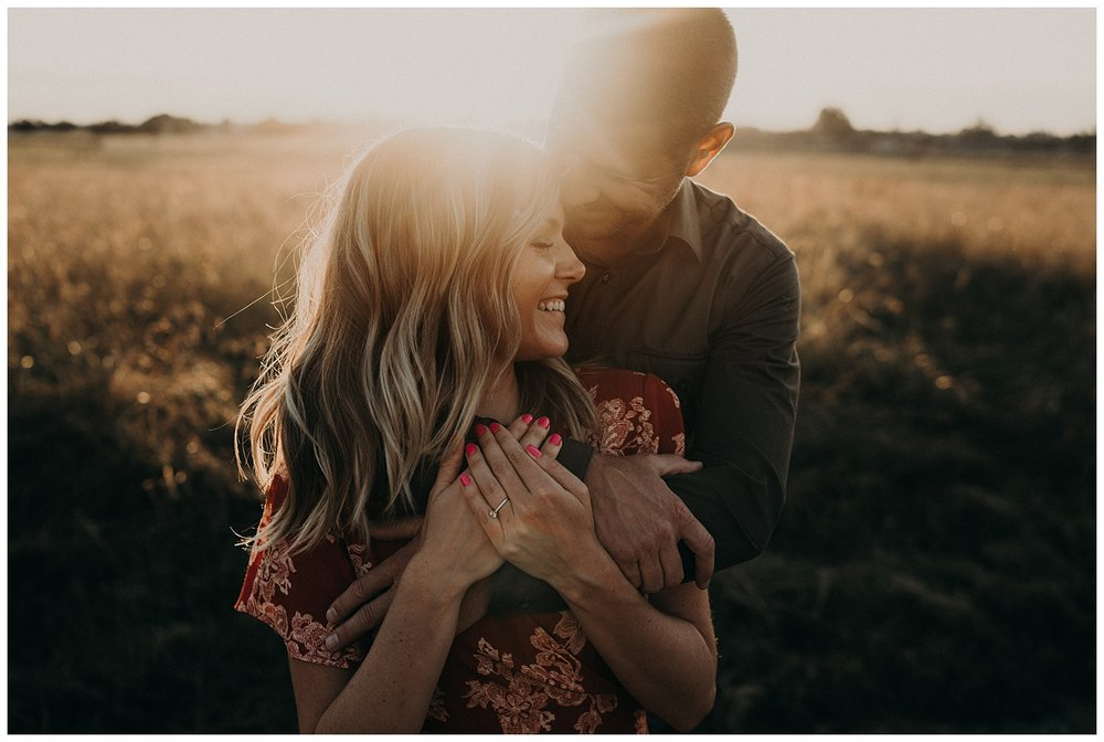 golden open field engagement session