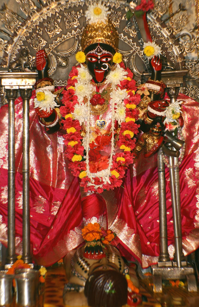 Bhavatārinī Kālī (standing on Śiva) as enshrined at Dakshineshwar. One of many forms of Kālī, who is the prototypical Tantric goddess, but only this Bengali version is popular today.