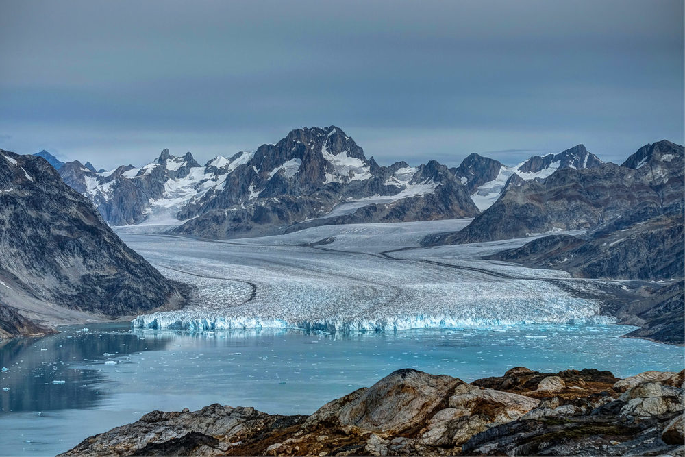 Knud Rasmussen glacier, the magnificent glacier flows into icy waters of Karale fjord, East Greenland. The glacier is named after a similarly magnificent man, Danish polar explorer Knud Rasmussen