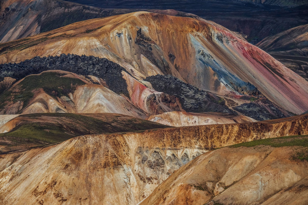 Nature's palette, amazing colours of Brennisteinsalda Mountain, Landmannalaugar Highlands. For scale reference - there is a tiny speck of a hiker on a trail just left of the hill's top.