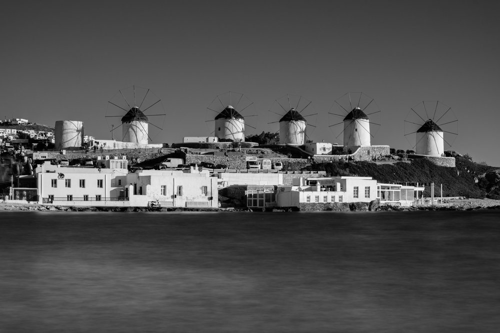 Windmills of Mykonos. Built by Venetians in 16th century to mill wheat; there are 16 windmills on Mykonos, seven of which are on the hill in Chora.
