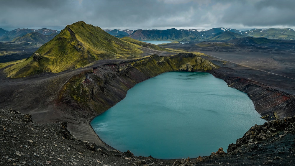 Beautiful highlands of Iceland. This is Bláhylur (Blue Pool) Hnausapollur Crater Lake, formed by eruption over thousand years ago it is located in the Fjallabak Nature Reserve area northeast of Landmannalaugar. The other lake on background is Ljótipollur. (XF 16-55mm f2.8 at 16mm 1/40s f11 ISO200)
