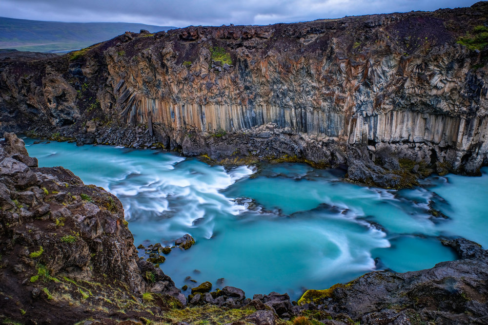 Basalt columns frame the Skjálfandafljót river just downstream of the Aldeyjarfoss waterfall, which is most commonly the subject of photographs. The columns however are beautiful on their own. The river is fed by the Vatnajökull glacier. (XF 16-55mm f2.8 at 16mm 25s f11 ISO200)