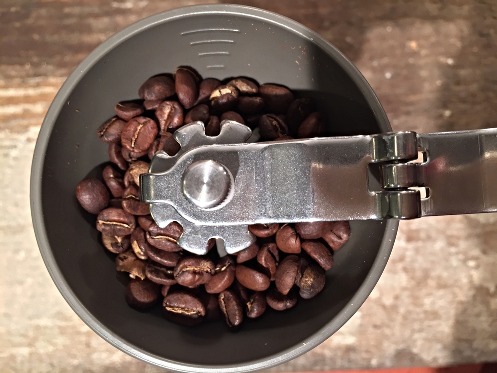 Fill the grinder to the 2nd line with Loam Coffee
