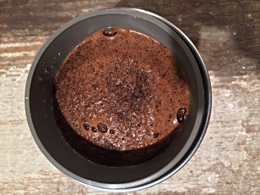 Pour enough water to saturate the beans. Let coffee bloom for 45 seconds