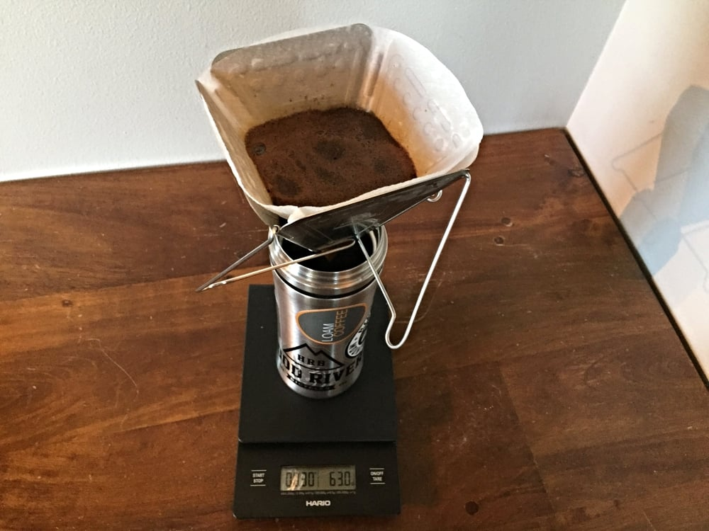Add 50g-60g of water and let the coffee bloom for 30-45 seconds