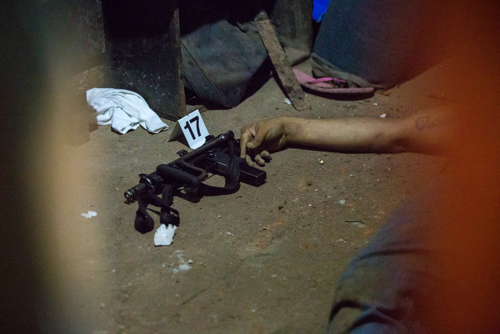 AYAGUALO, EL SALVADOR. The dead body of an gang member at the scene of a gang-police shootout.