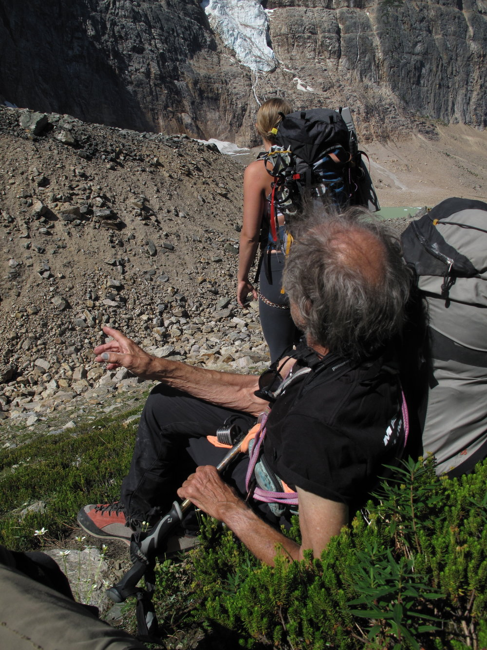 Fred regaling me with tales of his first ascent of the Angel Glacier, seen in the distance.