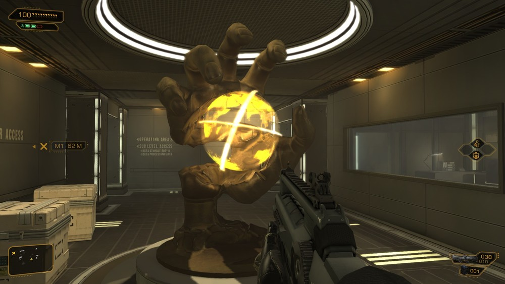 Deus Ex: Human Revolution . What self-respecting propaga- ..*ahem* news agency  wouldn't  want a statue of a godlike hand grasping a helpless Earth?