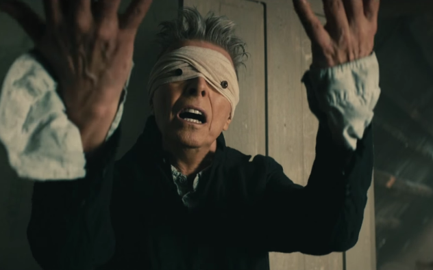 Bowie convulses behind Oedipal pinhole-eyes in the video for Blackstar.