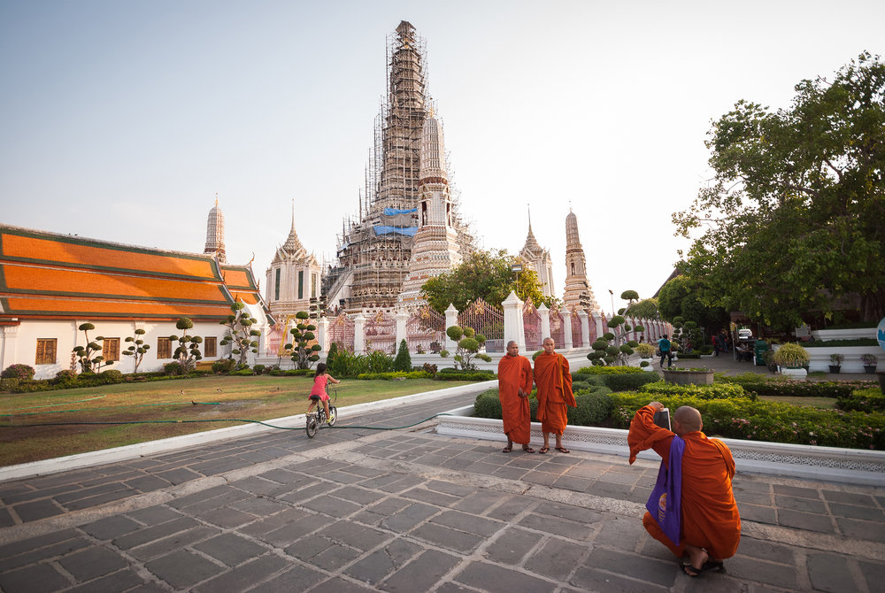 Monks having fun at Wat Arun (Temple of Dawn), Thailand