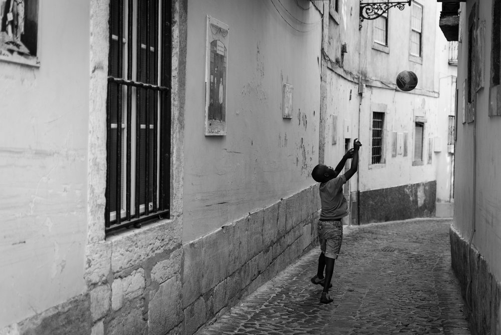 Any street is good for playing with a ball. Lisbon, Portugal