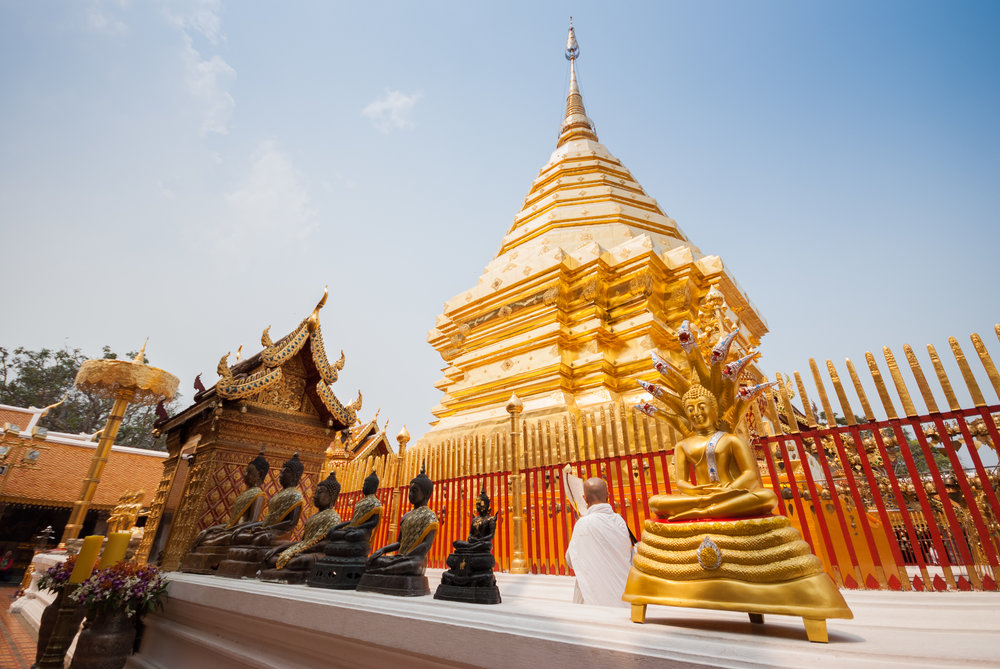 Doi Suthep is a sacred site to many Thai people. The temple is 15 kilometres (9.3 mi) from the city of Chiang Mai and after you climb 309 steps to reach the pagodas, you'll find a peaceful site to pray. Chiang Mai, Thailand