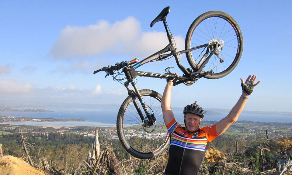 6)Rainbow over Whakarewarewa and Rotorua. John White celebrates his 24-hour solo world title after returning home.