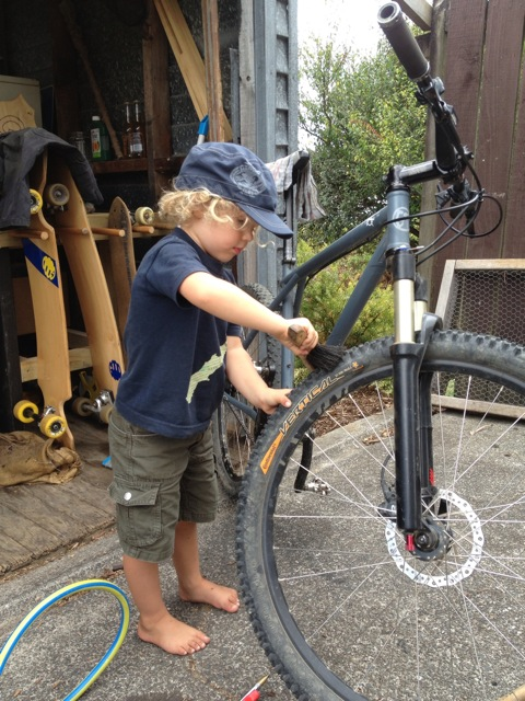 Jeff's son Indi helps with some bike maintenance.