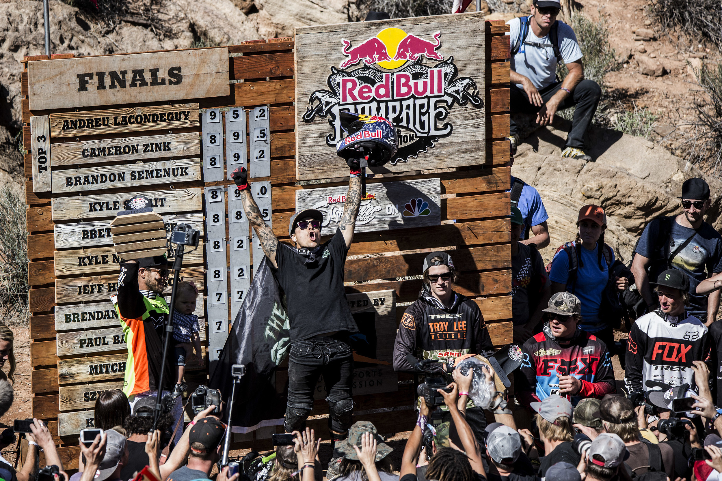 Event winner Andreu Locondeguy (C) of Spain, second placed Cameron Zink (L) of the USA and third placed Brandon Semenuk of Canada celebrate on the podium after the finals of Red Bull Rampage in Virgin, Utah, USA on 29 September 2014.