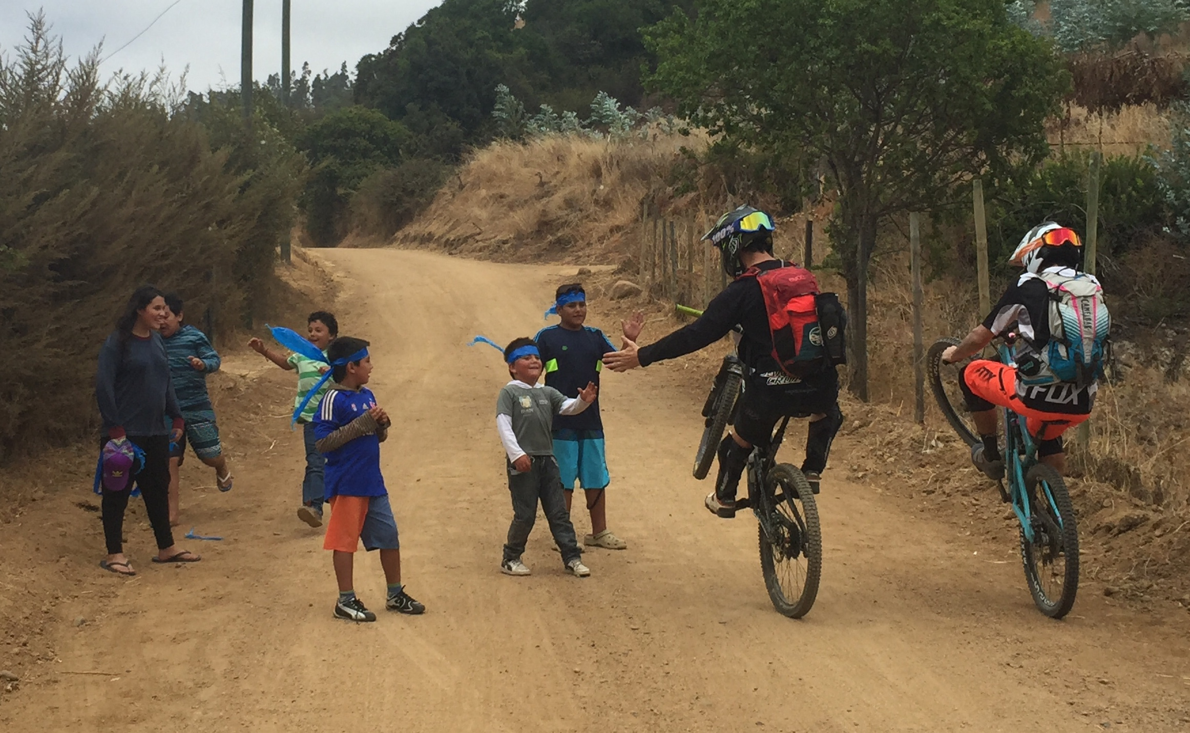 Santa Cruz marketing man and BMX legend Allan Cooke high 5's some local kids who were out cheering us on.