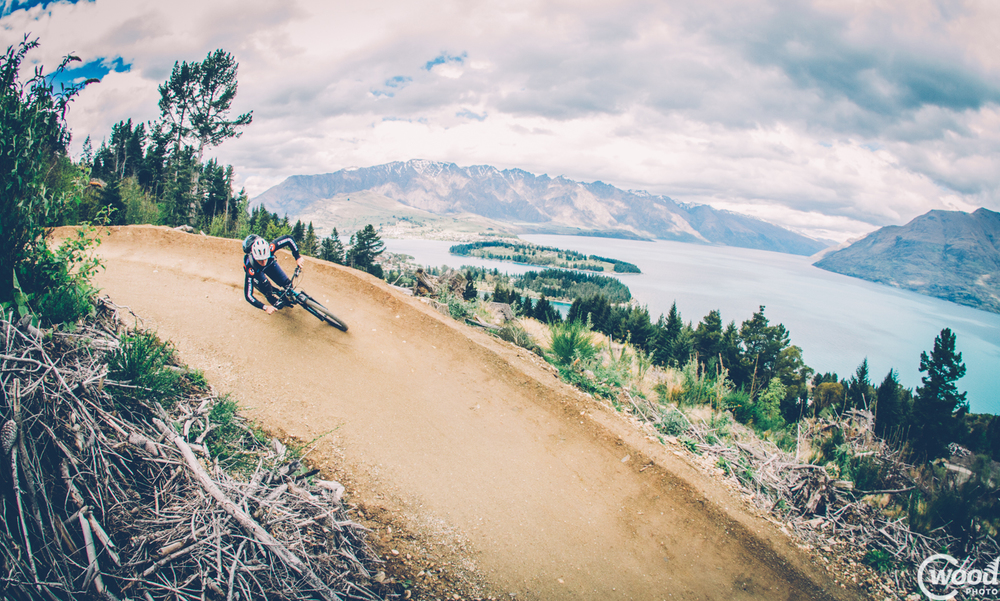 Queenstown rider Tim Ceci takes on one  of the most scenic MTB corners in the world ­ on Queenstown Bike Park¹s Thundergoat trail. Photo by Callum Wood
