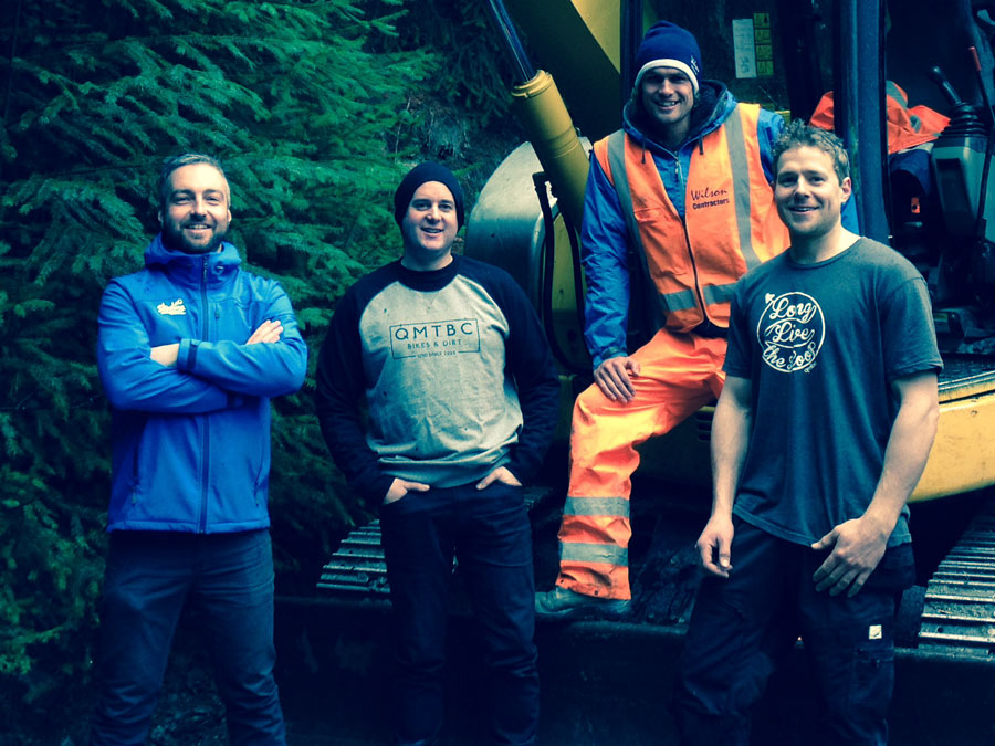 (From left) Skyline MTB Operations Manager Justin Matthews, QMTBC Committee Member Fraser Gordon, Calum Wilson from Wilson Contracting and Kepler Rek, QMTBC Downhill Sub-Committee Member get ready for excavation works on the Queenstown Bike Park's new gravity jump trail.