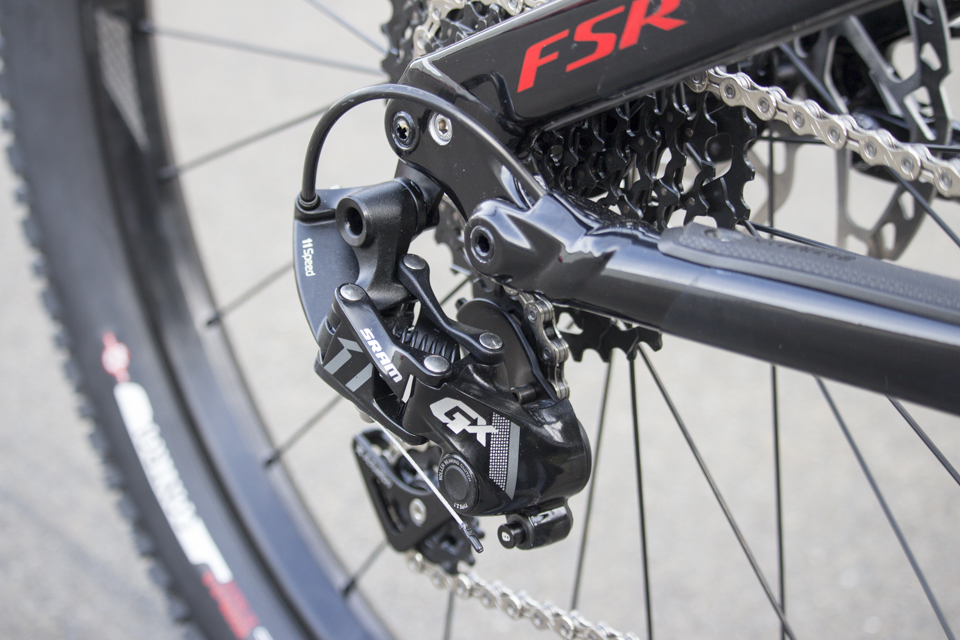 A 10-42 tooth cassette and SRAM's 11 speed X-Horizon GX derailleur out back.