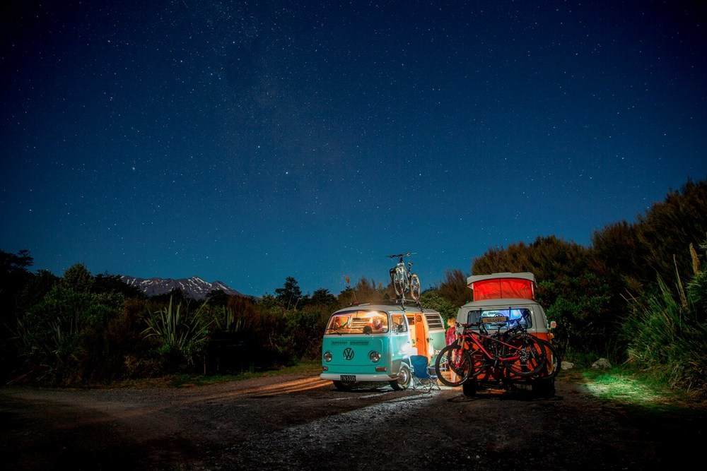 A Kombi-camping group of riders pull up under the stars and the watchful Mt Tongariro, Ruapehu, New Zealand. Photo: Camilla Rutherford