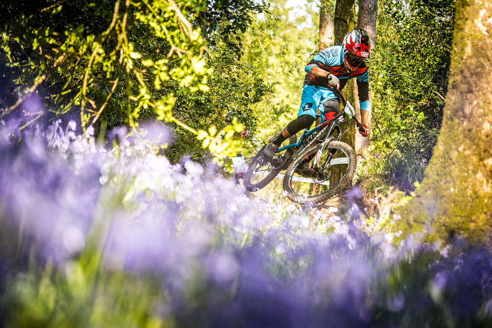 Adrien riding fast and smooth even with a broken hand amidst the pretty flowers.  Photo: Lapierre- Jeremy Reuiller